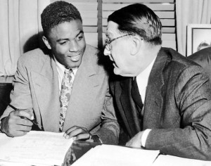 Branch Rickey signs Jackie Robinson