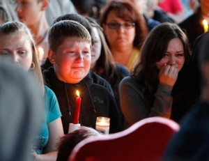 Supporters grieve at a candlelight vigil after the shooting at Reynolds High School in Troutdale, Ore.