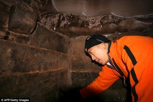 This picture released by the evangelical group claims to show one of the explorers examining part of a structure which they claim might prove the existence of Noah's Ark on Mount Ararat. There are no external images of the site and the Hong Kong-based group refuse to say precisely where they made their discovery until the Turkish government designate it an archaeological site.