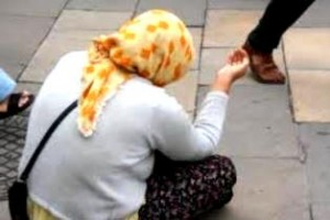 A woman begging on the street