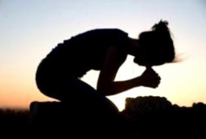 Silhouette of a Young Woman Praying