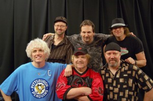"""Back Row (Left to Right): Tom Milnes, Guitar; Tom Tincha, Guitar; Jimmy """"Vegas"""" Tanner, Drums Front Row (Left to Right): J. Jackson, Vocals; Keith Haynie, Bass; Bill Hubauer, Keyboards"""