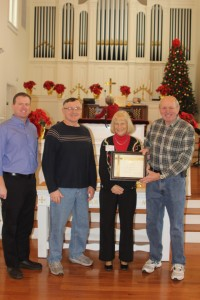 Rev. Doug Forbes and Rev. Bruce Smith present Rev. Dennis and Elaine O'Neill with a Certificate of Appreciation to acknowledge their concern for and assistance to disaster victims.  (Left to right are Rev. Bruce Smith, Rev. Dennis and Elaine O'Neill and Rev. Doug Forbes.)