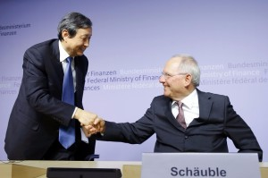 German Finance Minister Wolfgang Schäuble, right, and China's Vice Premier Ma Kai shake hands at a joint news conference in Berlin on Tuesday. Mr. Schäuble said Germany will be a founding member of a new international development bank backed by China, along with other European countries. Photo: Reuters