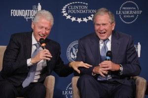 WASHINGTON, DC - SEPTEMBER 08:  Former U.S. presidents Bill Clinton (L) and George W. Bush share a laugh during an event launching the Presidential Leadership Scholars program at the Newseum September 8, 2014 in Washington, DC. With the cooperation of the Clinton, Bush, Lyndon B. Johnson and George H. W. Bush presidential libraries and foundations, the new scholarship program will provide 'motivated leaders across all sectors an opportunity to study presidential leadership and decision making and learn from key administration officials, practitioners and leading academics.'  (Photo by Chip Somodevilla/Getty Images)