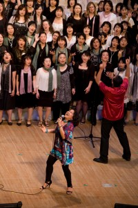 Bola joyfully singing praises to God with a Gospel choir.