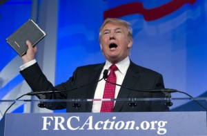 Republican presidential candidate, businessman Donald Trump, holds up his bible who was giving to him by his mother as he speaks during the Values Voter Summit, held by the Family Research Council Action, Friday, Sept. 25, 2015, in Washington ( AP Photo/Jose Luis Magana) ORG XMIT: DCJL120
