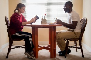 Ashley (Kate Mara) reads to Brian (David Oyelowo) over pancakes.