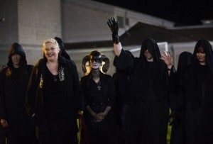 Members of the Seattle chapter of the Satanic Temple wave to yelling students outside of the gates at Memorial Stadium in Bremerton during a football game between the Bremerton Knights and the Sequim Wolves on Thursday, Oct. 29, 2015. Bremerton assistant football coach Joe Kennedy was placed on administrative leave on Wednesday following his decision to pray on the field after he was told not to by the school district. The Satanic Temple of Seattle announced this week that they planned to be at the game on Thursday after a 12th-grader at Bremerton High School had requested the group perform a satanic invocation.