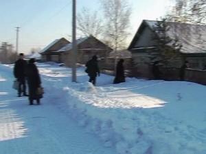 Village Outreach Team Going Door To Door In Russia