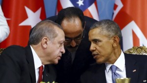Turkish President Recep Tayyip Erdogan, left, and U.S. President Barack Obama chat during a session of the G-20 Summit in Antalya, Turkey, Nov. 15, 2015.