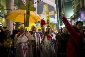 Pro-democracy protesters from a politically active Christian church, hold up yellow umbrellas, a symbol of the Occupy Central civil disobedience movement, as they sing Christmas carols at Times Square in Hong Kong early on December 25, 2014. Photo courtesy of REUTERS/Tyrone Siu *Editors: This photo may only be republished with RNS-CHINA-CHRISTIANS, originally transmitted on March 8, 2016.