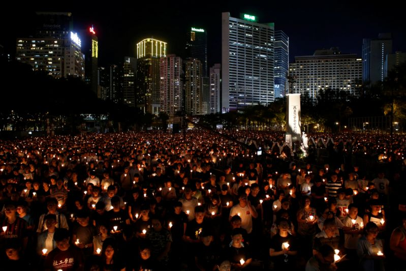 Thousands of people take park in a candlelight vigil to mark the 27th anniversary of the crackdown of pro-democracy movement at Beijing's Tiananmen Square in 1989, at Victoria Park in Hong Kong June 4, 2016. REUTERS/Bobby Yip TPX IMAGES OF THE DAY