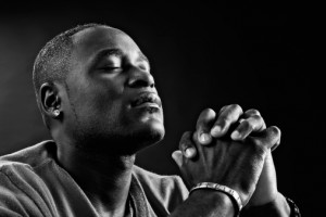 Devout African-American man praying fervently in black-and-white