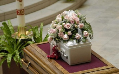Federal judge puts baby burial rule on hold