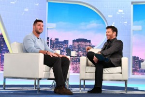 Tim Tebow appearing with Harry Connick Jr.