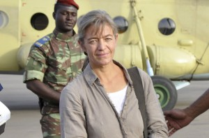 FILE- In this file photo taken Tuesday, April 24, 2012, released Swiss hostage Beatrice Stockly, left, arrives by helicopter from Timbuktu, Mali after being handed over by a militant Islamic group Ansar Dine, in Ouagadougou, Burkina Faso. A Swiss woman who had been briefly abducted back in 2012 was kidnapped again by suspected jihadists who scaled the walls of her home in northern Mali in the middle of the night, authorities said Friday, Jan. 8, 2016,  Witnesses say Beatrice Stockly's door was found open Friday morning in Timbuktu, the town where she returned the year after her first kidnapping. (AP Photo/Brahima Ouedraogo, File)