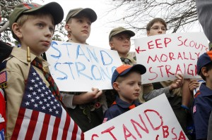 "(clockwise from left) Boy Scouts Eric Kusterer, Jacob Sorah, James Sorah, Micah Brownlee and Cub Scout John Sorah hold signs at the ""Save Our Scouts"" Prayer Vigil and Rally in front of the Boy Scouts of America National Headquarters in Irving, TX Wednesday, February 6, 2013. (AP Photo/Richard Rodriguez)"