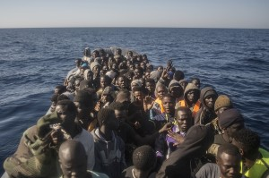 Refugees and migrants from different African countries wait to be assisted by an NGO aboard an overcrowded rubber boat, about 20 miles North of Sabratha, Libya, Saturday, March 4, 2017. A rescue ship belonging to a Spanish NGO has saved 250 migrants in danger of capsizing near the Libyan coast on Saturday. Proactiva Open Arms spokesperson Laura Lanuza says that the NGO's boat rescued the African migrants from two small rubber vessels that were at risk of being overwhelmed by the sea. (AP Photo/Santi Palacios)
