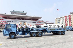 In this Saturday, April 15, 2017, photo distributed by the North Korean government, Polaris submarine launched ballistic missiles (SLBM) are paraded to celebrate the 105th birth anniversary of Kim Il Sung, the country's late founder, in Pyongyang, North Korea. China is defending its trade practices with North Korea after Chinese-made vehicles were seen carrying ballistic missiles during a military parade despite international sanctions against selling military hardware to Pyongyang. (Korean Central News Agency/Korea News Service via AP)