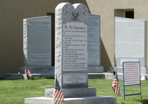 This May 15, 2012, photo shows the Bloomfield Ten Commandments monument at the City Hall in Bloomfield, N.M. The New Mexico municipality that wants to keep a 6-foot-tall Ten Commandments monument outside city hall is asking a federal appeals court to overturn a judge's ruling deeming the display unconstitutional. They'll make their case Wednesday, Sept. 30, 2015, before the 10th Circuit Court of Appeals in Denver. (Jon Austria/The Daily Times via AP) MANDATORY CREDIT