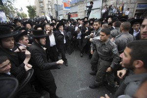 Hundreds of Ultra orthodox Jewish clash with Israeli police during a protest in Jerusalem on April 10, 2014, following the arrest of a haredi draft-dodger and against  a bill intended to enforce the haredi enlistment into the IDF (Israel Defense Force). Photo by Yonatan Sindel/Flash90