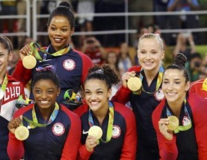 (Photo: Reuters/Mike Blake)Simone Biles, Gabrielle Douglas, Laurie Hernandez, Aly Raisman, and Madison Kochian pose with their gold medals.