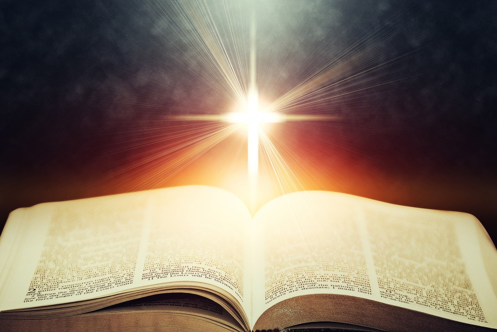 Light flares illuminating the Holy Bible.