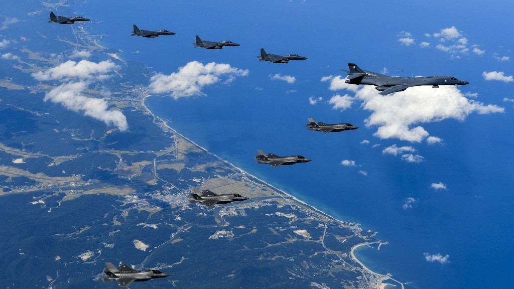 "This US Army handout photo obtained September 23, 2017 shows Air Force and Marine Corps aircraft conducting a mission with the South Korean air force over the Korean Peninsula, on September 18, 2017.  US bombers accompanied by fighter jets flew off the east coast of North Korea on September 23, 2017 in a show of force designed to project American military power in the face of Pyongyang's weapons programs, the Pentagon said. It was the furthest north of the Demilitarized Zone (DMZ) any US fighter or bomber aircraft have flown off North Korea's coast in this century, Pentagon spokesman Dana White said.  / AFP PHOTO / US ARMY / Steven SCHNEIDER / RESTRICTED TO EDITORIAL USE - MANDATORY CREDIT ""AFP PHOTO / US ARMY/STEVEN SCHNEIDER/HANDOUT"" - NO MARKETING NO ADVERTISING CAMPAIGNS - DISTRIBUTED AS A SERVICE TO CLIENTS STEVEN SCHNEIDER/AFP/Getty Images"