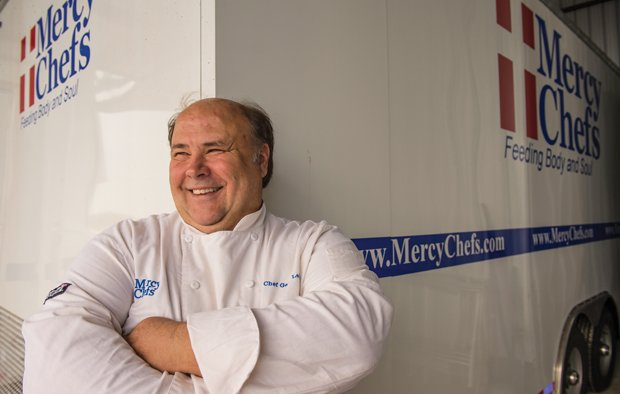 The Joy of Cooking - Gary LeBlanc in front of one of Mercy Chefs' mobile kitchens
