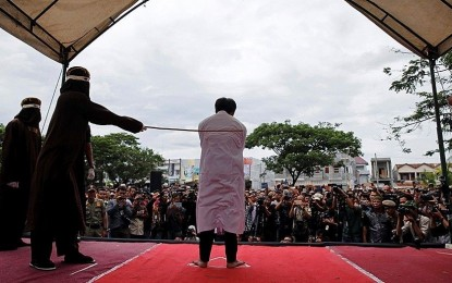 Indonesian Christians flogged outside of mosque for violating sharia law