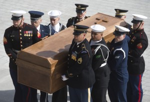 WASHINGTON, DC - FEBRUARY 28: (AFP-OUT) A joint U.S. Military honor guard carries a casket containing the remains of evangelist Rev. Billy Graham at the U.S. Capitol, on February 28, 2018 in Washington, DC. Rev. Graham is being honored by Congress by lying in repose inside of the U.S. Capitol Rotunda for 24 hours. (Photo by Saul Loeb-Pool/Getty Images)
