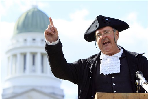 Garrett Lear, the Patriot Pastor, of Wakefield, N.H., addresses a crowd at a tea party rally in Capitol Park, Thursday, April 15, 2010, in Augusta, Maine. (AP Photo/Robert F. Bukaty)