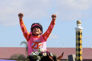 DEL MAR, CA - NOVEMBER 04:  Jockey Mike Smith celebrates after riding Caledonia Road to a win in the  14 Hands Winery Breeders' Cup Juvenile Fillies race on day two of the 2017 Breeders' Cup World Championship at Del Mar Race Track on November 4, 2017 in Del Mar, California.  (Photo by Sean M. Haffey/Getty Images)