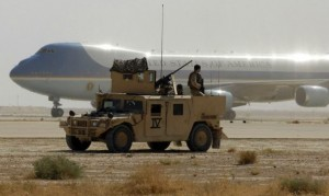 A U.S. Navy SEAL team helps secure the airfield as Air Force One lands at Al Asad Air Base, Iraq, Sept. 3, 2007.  President George W. Bush, Secretary of State Condolezza Rice, Secretary of Defense Robert M. Gates, Chairman of the Joint Chiefs of Staff Gen. Peter Pace, U.S. Central Command Commander Adm. William J. Fallon, Commander of Multinational Forces-Iraq Gen. David Petreaus, Commander of Multinational Corps-Iraq Lt. Gen. Ray Odierno, and others met at Al Asad to meet with Iraqi government leadership, sheiks from all over Anbar province and U.S. Servicemembers deployed to Iraq.  Defense Dept. photo by Cherie A. Thurlby (released)