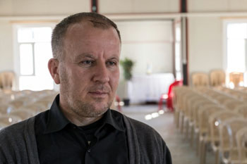 Monk run over by US tank, then attacked by ISIS, now ministers to refugees